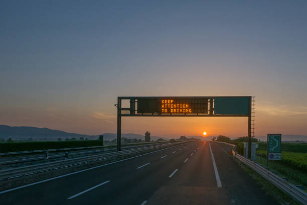 keep attention to driving written on highway road sign - detraction stock pictures, royalty-free photos & images