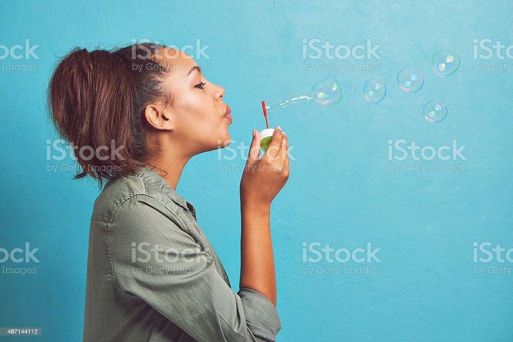 Keep calm and blow bubbles stock photo