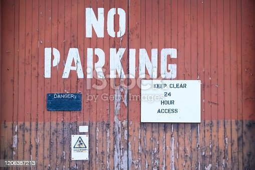 Keep clear at all times no parking 24 access required sign at factory entrance door uk