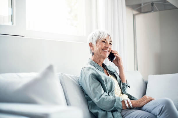 keep in touch, keep smiling - older woman phone stock photos and pictures