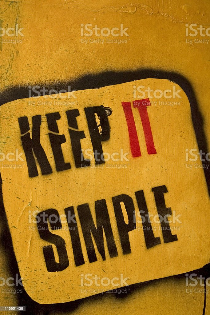 Keep IT Simple Message Graffiti Painted Words Text Stencil Wall royalty-free stock photo
