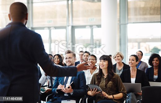 Shot of a group of businesspeople attending a conference