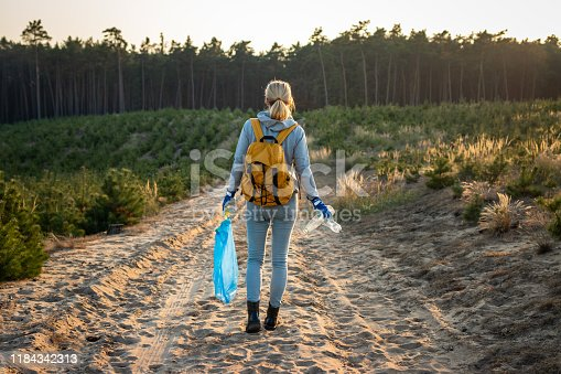 istock Keep nature without plastic pollution! Environmental volunteer in nature 1184342313