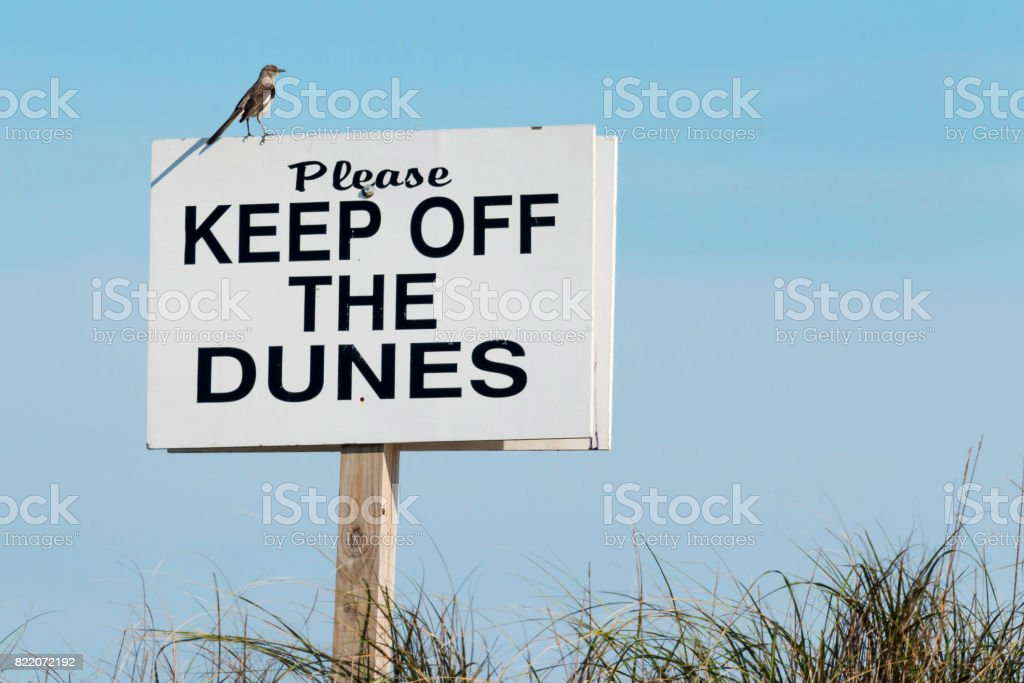 Keep of the dunes sign stock photo