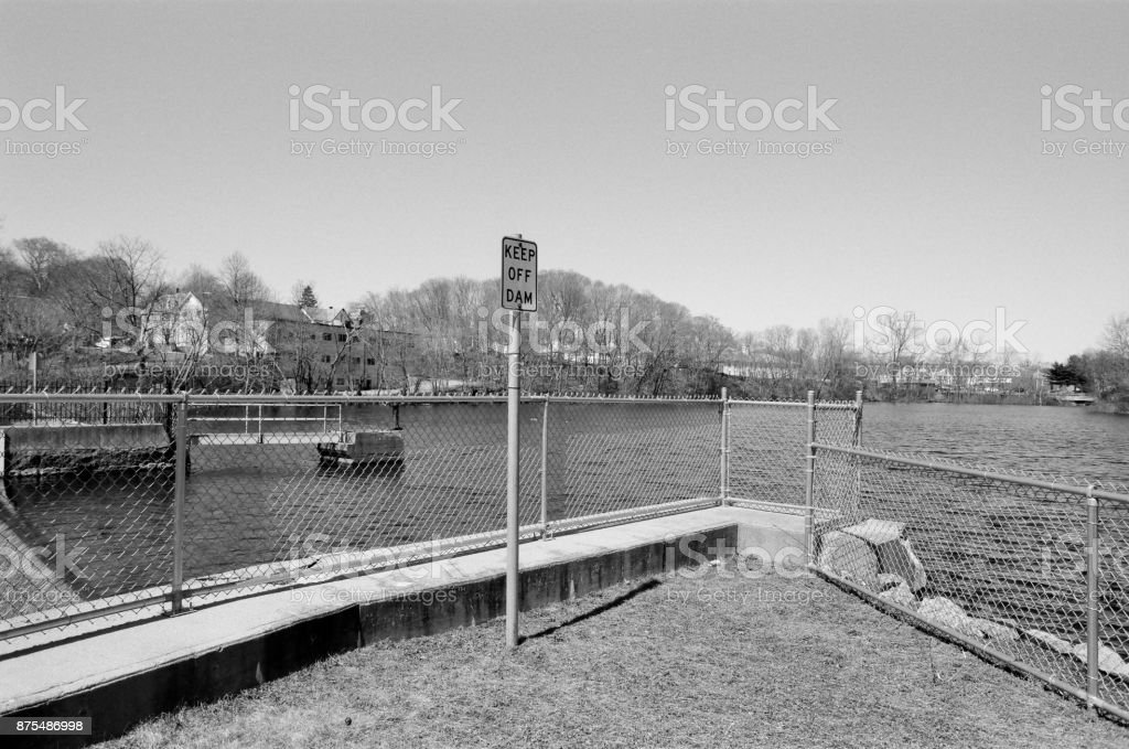 'Keep Off Dam' The 4th privilege dam, Mother Brook in the background, Dedham MA. stock photo