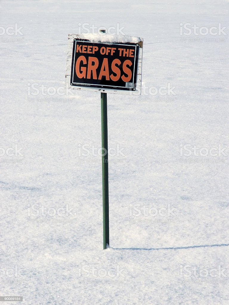 Keep off Grass sign in winter royalty-free stock photo