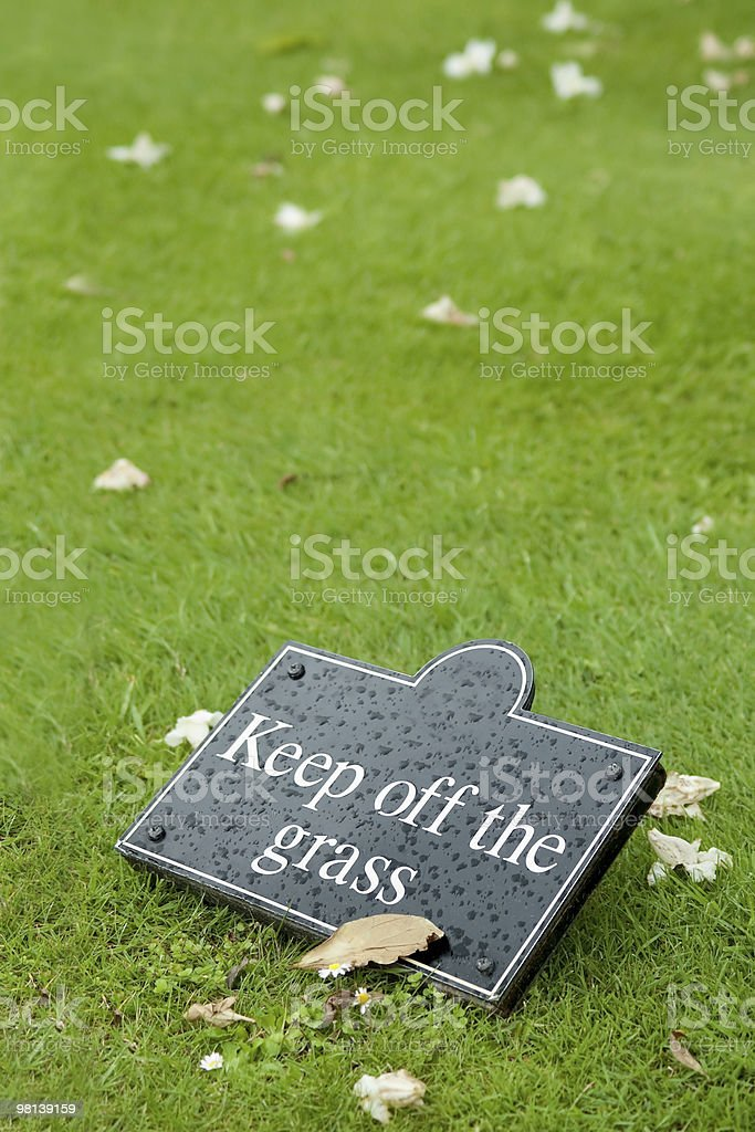 keep off the grass stock photo