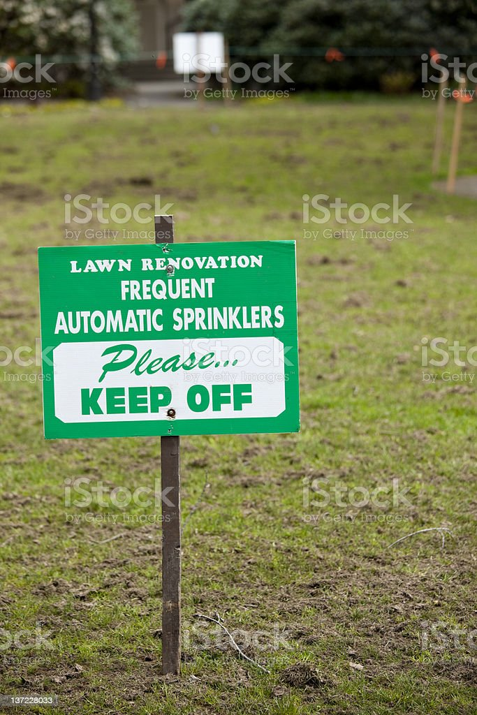 Keep off the grass warning sign for lawn seeding repair stock photo