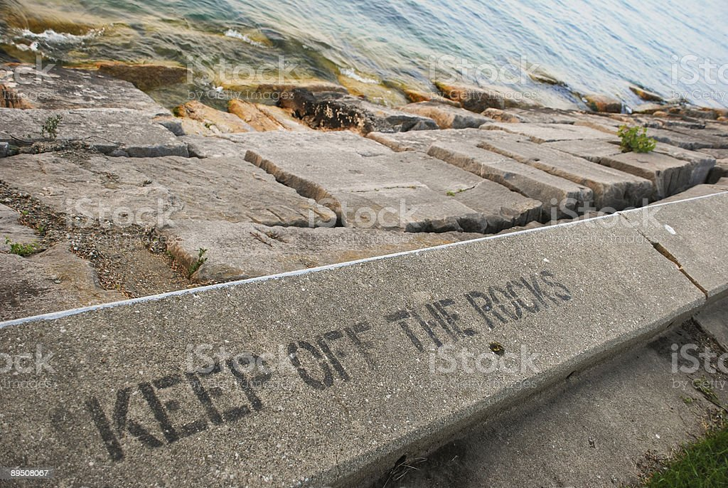 Keep Off The Rocks stock photo