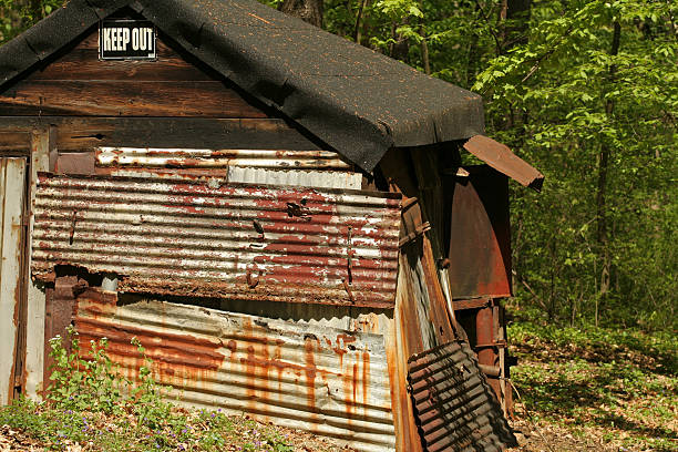 Keep Out! Old oil shed in back country dilapidate stock pictures, royalty-free photos & images