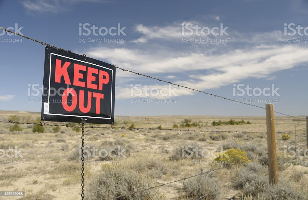 Keep Out sign on a barb wire fence stock photo