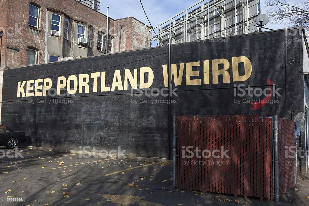 Keep Portland Weird sign painted on a building stock photo