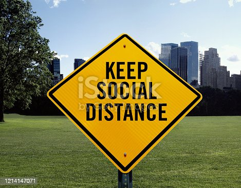 Keep social distance sign in Central Park in New York.