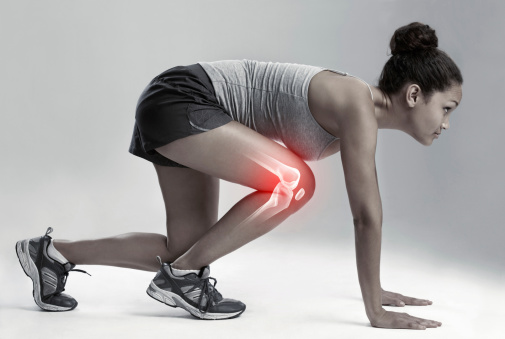 Full length studio shot of a female runner with cgi joint inflammation