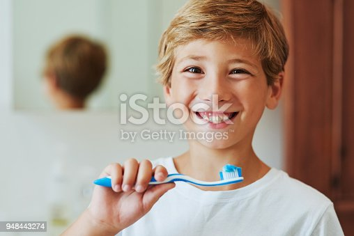 948443044istockphoto Keep your smile bright by brushing your teeth 948443274