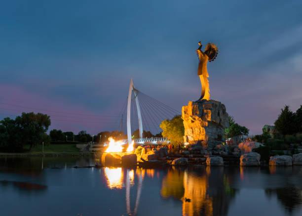 Wichita, Kansas, USA - August 13, 2017: Keeper of the Plains steel sculpture on the Arkansas River stock photo