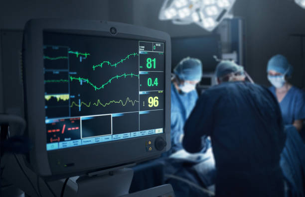 Keeping a close monitor on the patient's state of health Shot of a hospital monitor in an operating theatre pulse trace stock pictures, royalty-free photos & images