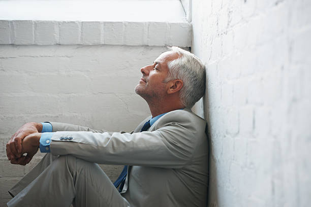 keeping a moment to himself - sitting on floor stock photos and pictures