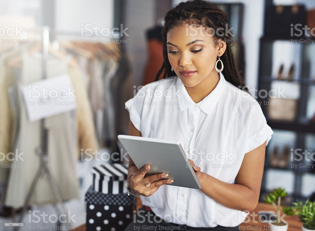 Keeping an eye on the latest fashons online royalty-free stock photo
