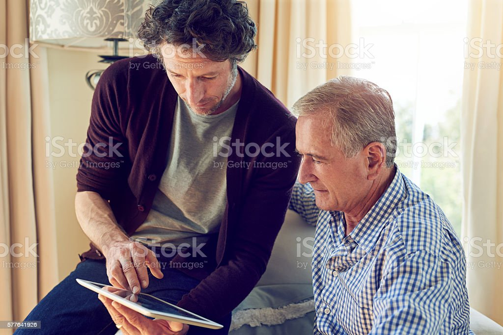 Keeping dad up to date stock photo