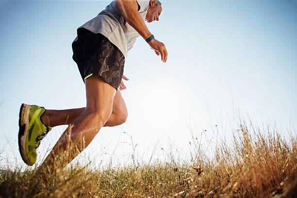 keeping fit in the morning - jogging hill bildbanksfoton och bilder