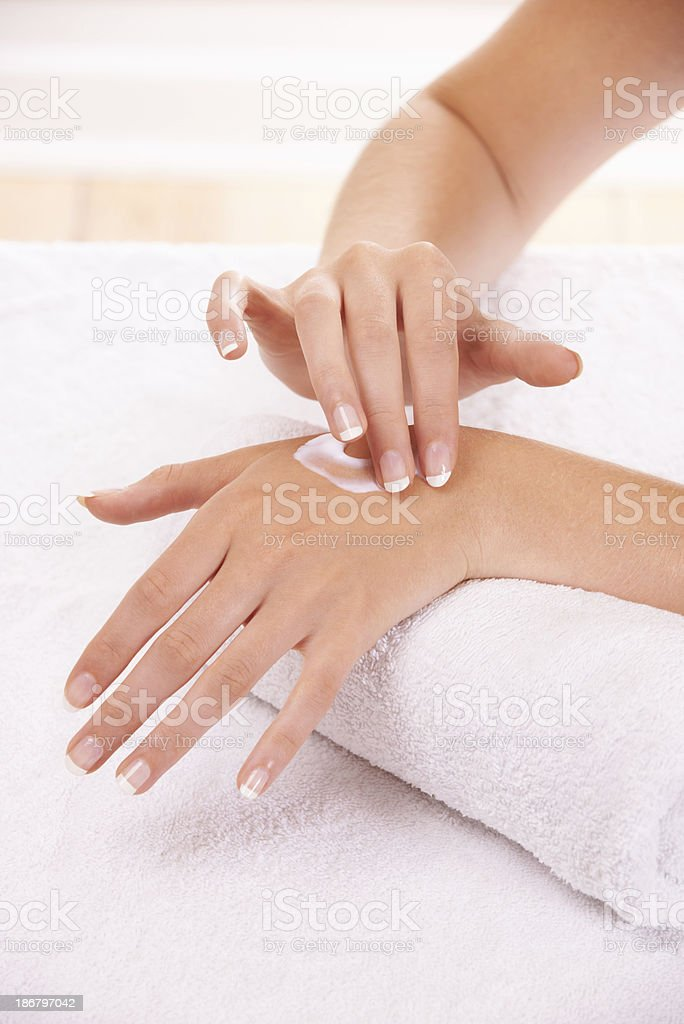 Keeping her hands silky smooth royalty-free stock photo
