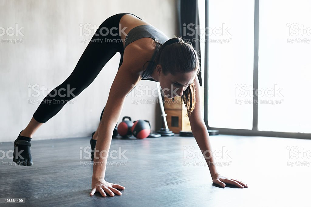 Keeping her muscles stretched to avoid injury stock photo