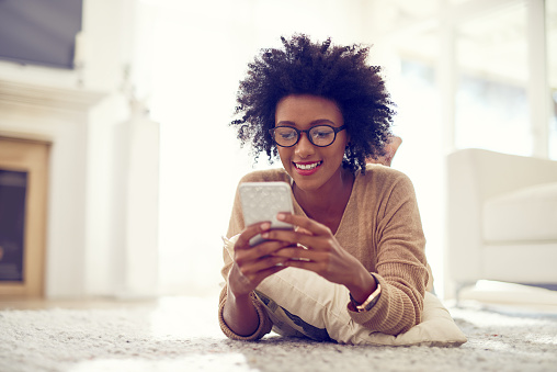 istock Keeping her phone fresh with some brand new apps 616898108