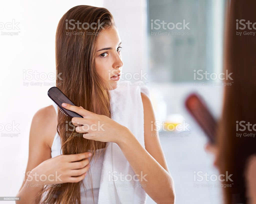 Keeping her silky and straight stock photo