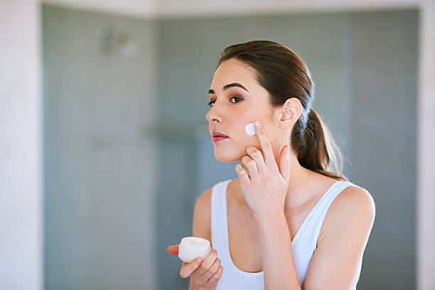 Keeping her skin clean and smooth stock photo