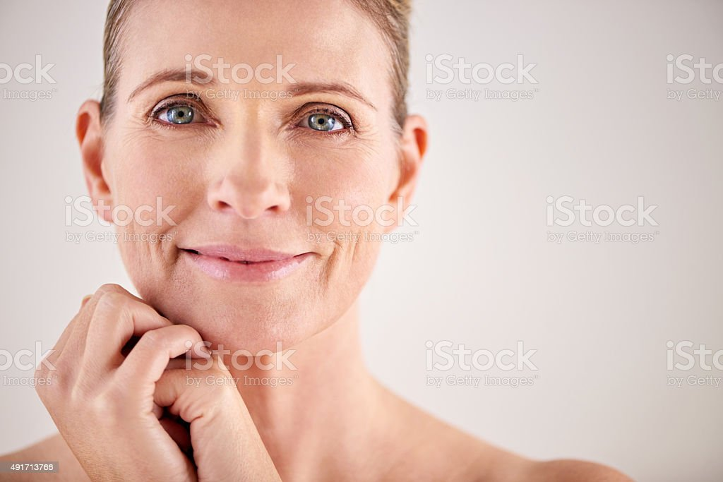 Keeping her skin looking great with good beauty habits stock photo