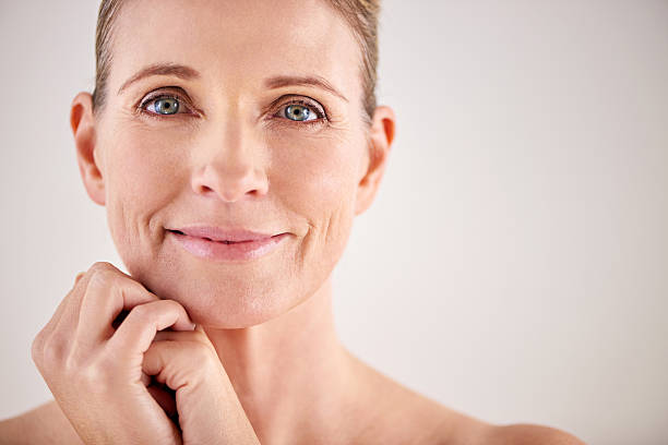 Keeping her skin looking great with good beauty habits Cropped studio portrait of an attractive mature womanhttp://195.154.178.81/DATA/i_collage/pi/shoots/784083.jpg only mature women stock pictures, royalty-free photos & images