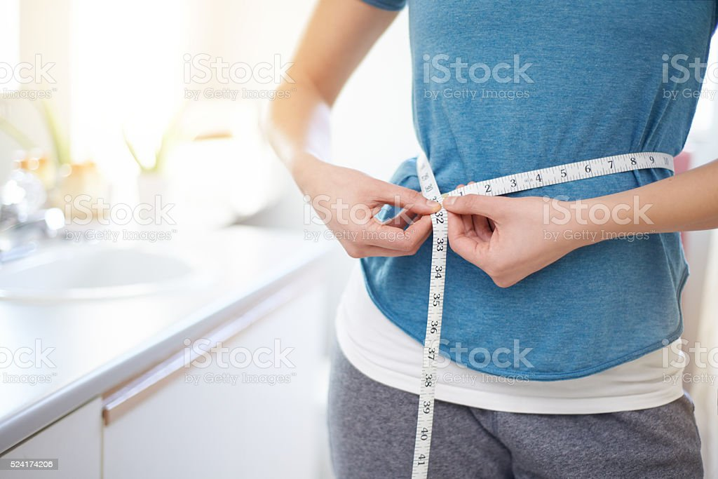 Keeping her waistline in check stock photo