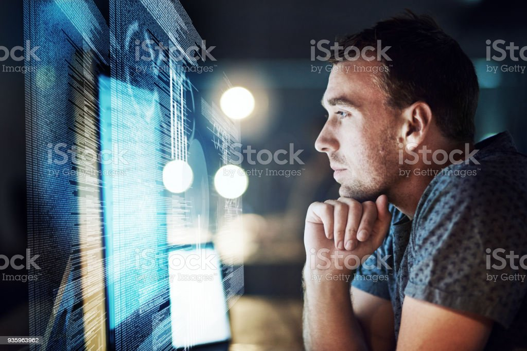 Keeping his focus as he cracks the code stock photo