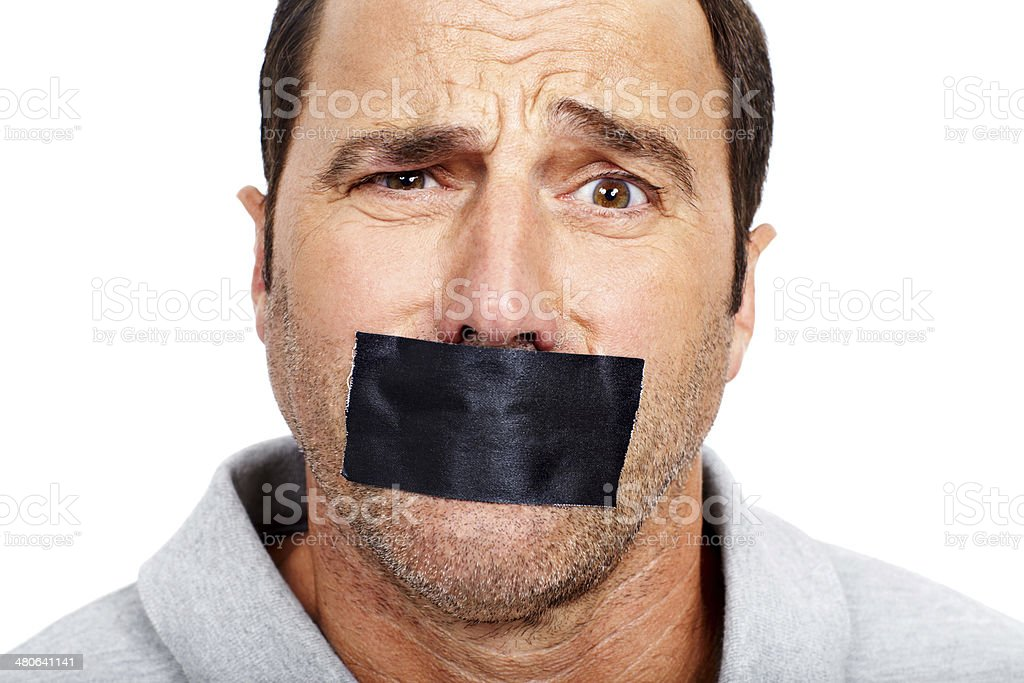 Keeping his opinions to himself royalty-free stock photo