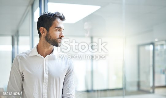 Cropped shot of a young businessman standing in his office