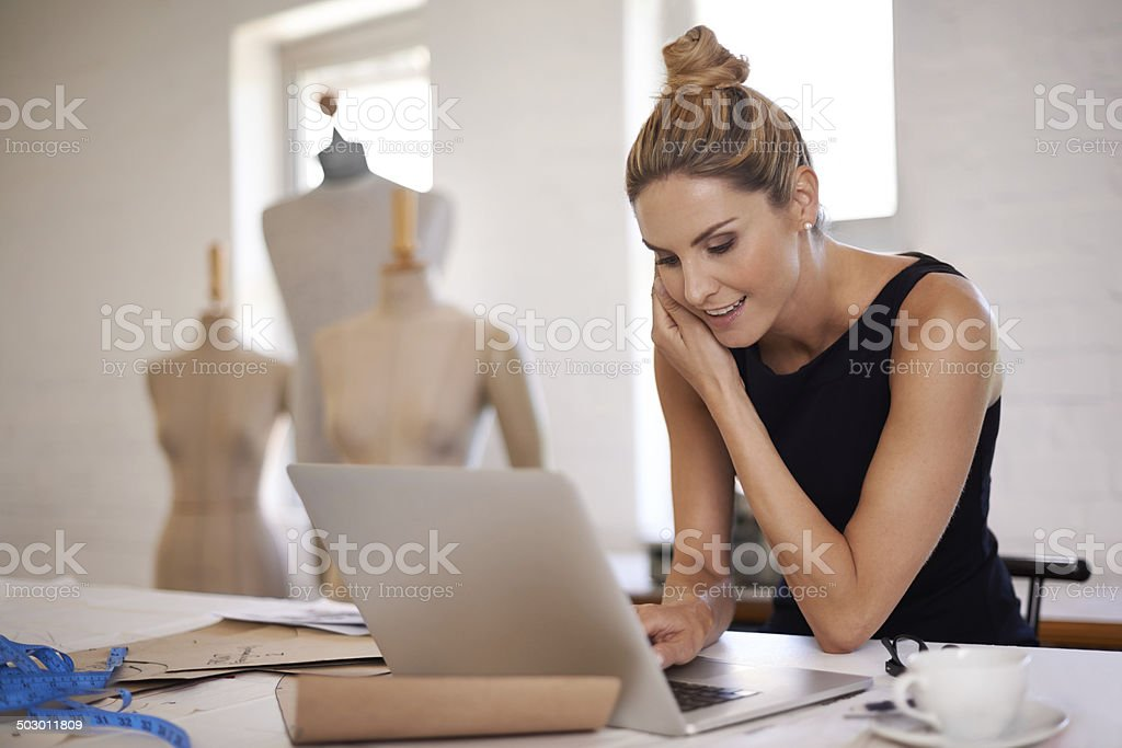 Keeping in touch with her suppliers stock photo