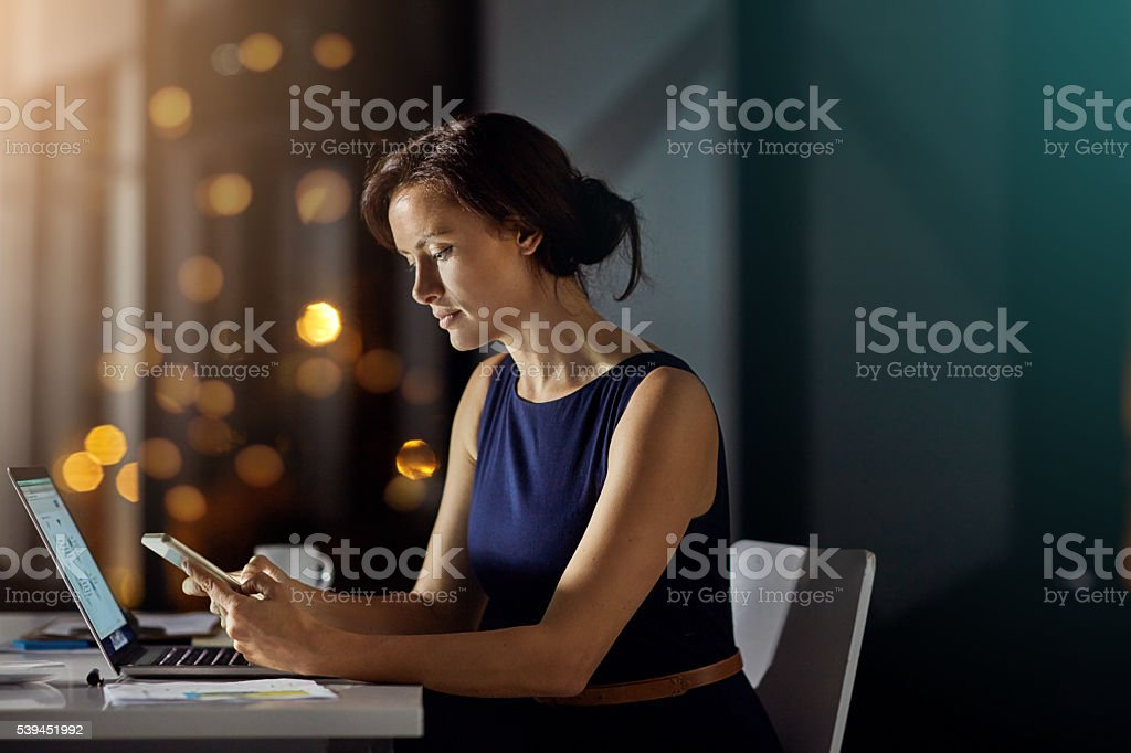 Keeping in touch with home during the late shift stock photo