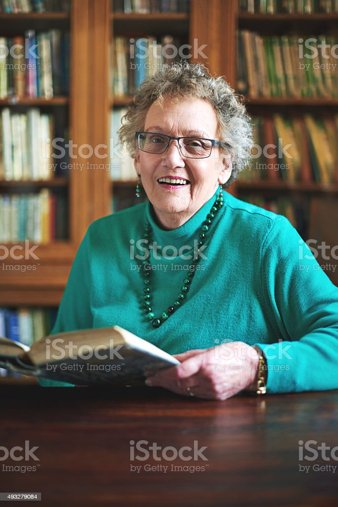 Keeping my mind sharp and enjoying every page of it! stock photo