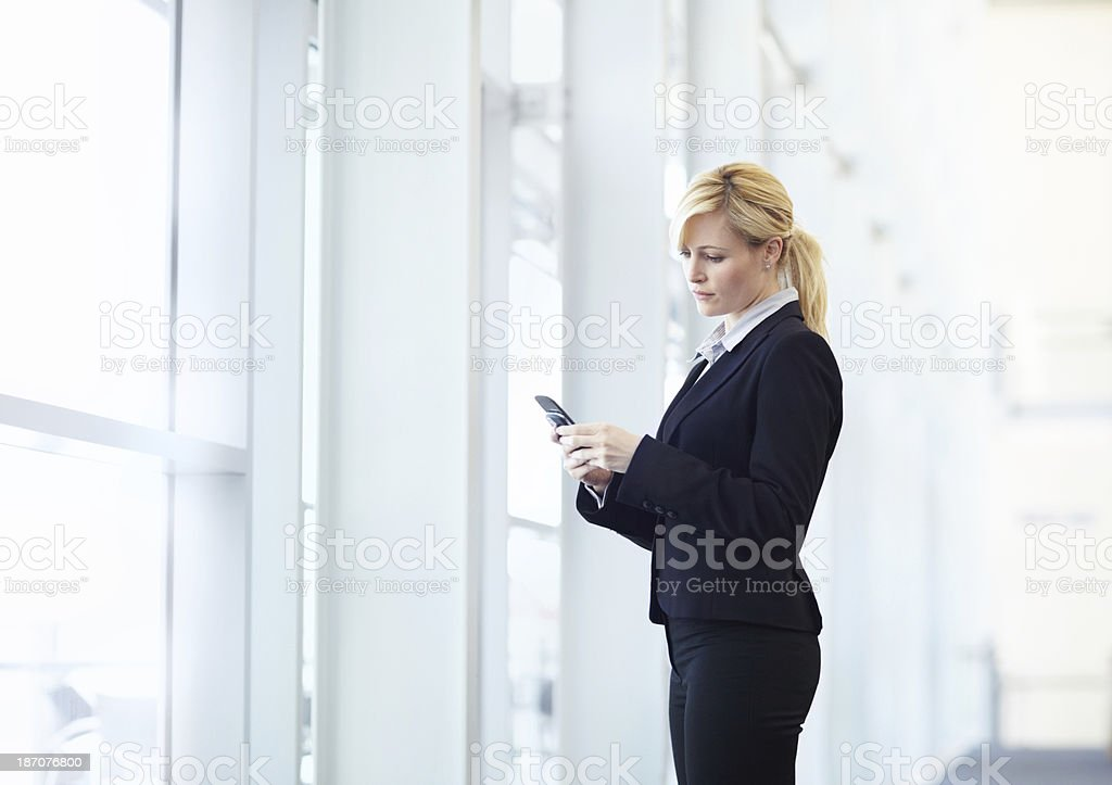 Keeping tabs on her many projects royalty-free stock photo