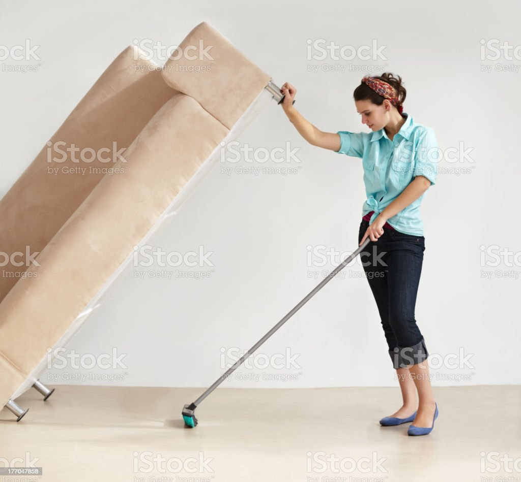 Keeping the house clean takes super strength! stock photo