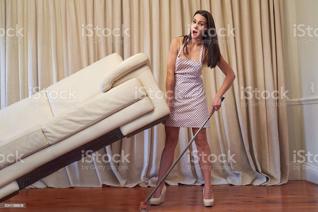 Keeping the house clean takes super strength stock photo
