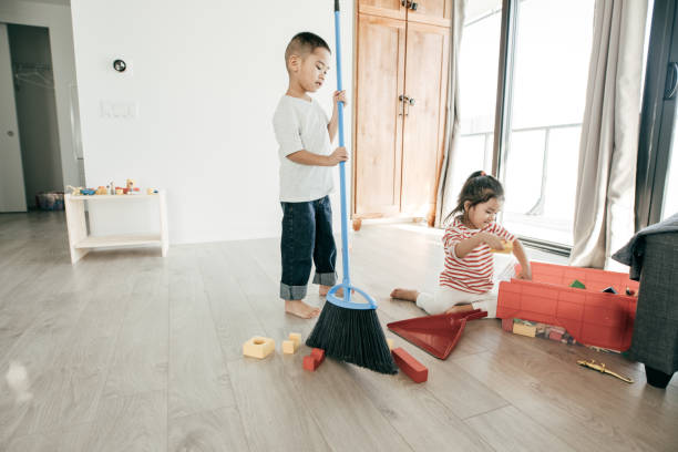 Keeping the room clean Two kids cleaning up the room kids cleaning up toys stock pictures, royalty-free photos & images
