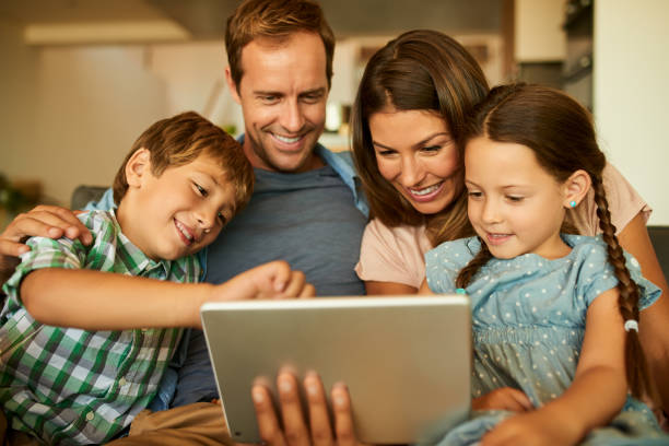Keeping their curious minds active with technology stock photo