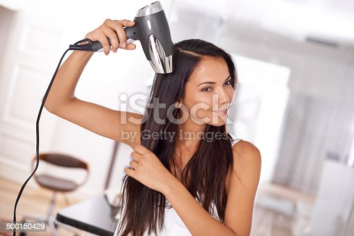 Shot of a beautiful young woman blow drying her hairhttp://195.154.178.81/DATA/i_collage/pi/shoots/783643.jpg