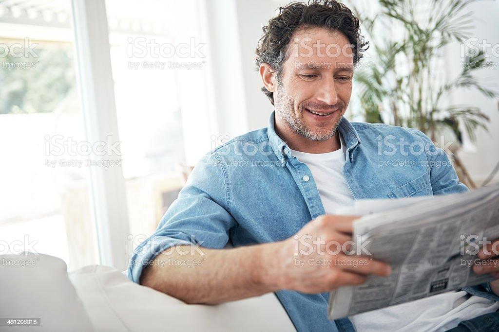 Keeping up with the latest news stock photo
