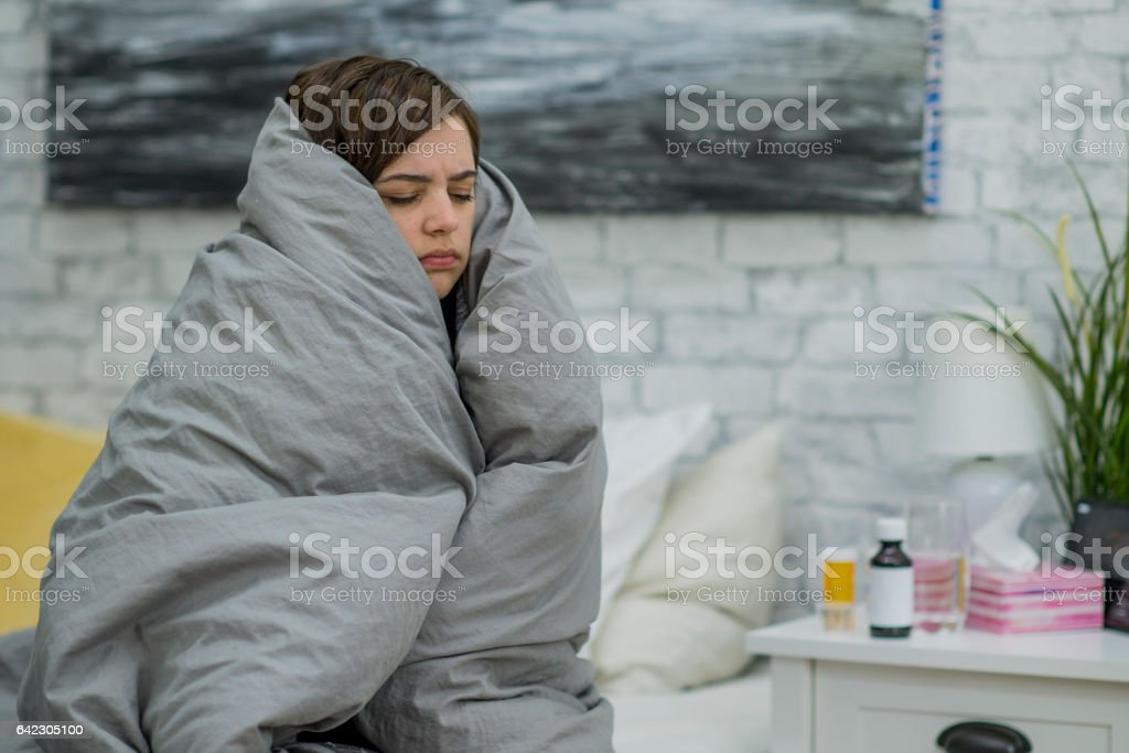 Keeping Warm While Home Sick stock photo
