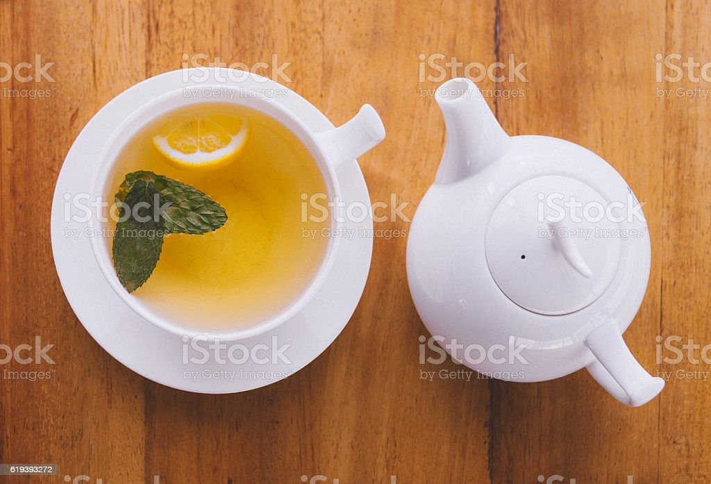 Keeping warm with cup of winter's Tea stock photo