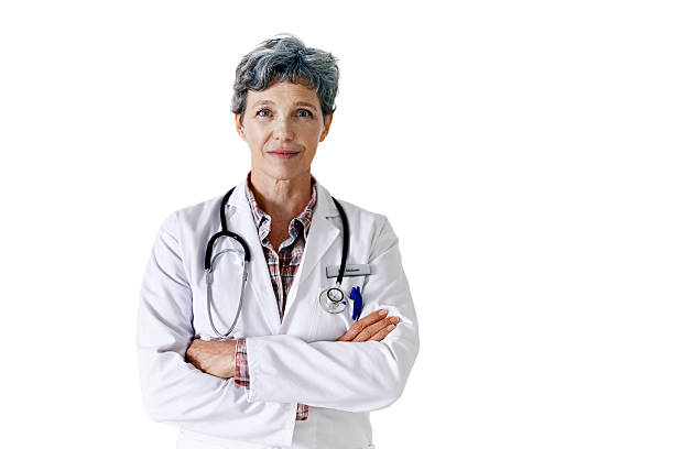 Keeping you healthy is my priority Studio portrait of a confident mature doctor standing against a white backgroundhttp://195.154.178.81/DATA/i_collage/pu/shoots/804719.jpg female doctor stock pictures, royalty-free photos & images