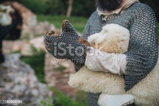 Man preparing his warm medieval coat